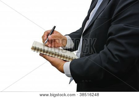 Businessman Writing Something In Notebook