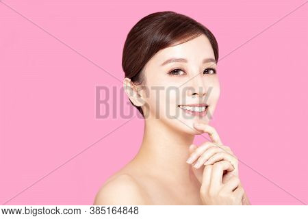 Close Up Of Beautiful Young Woman's Face With Clean Perfect Skin