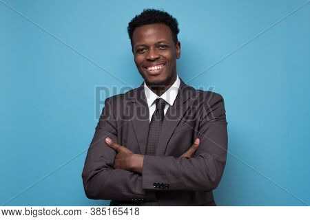 Happy African American Young Businessman Isolated Over Blue Background