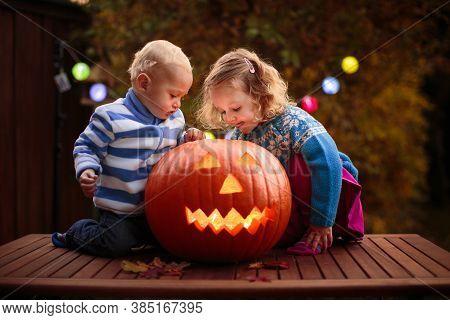 Kids Carving Halloween Pumpkin.
