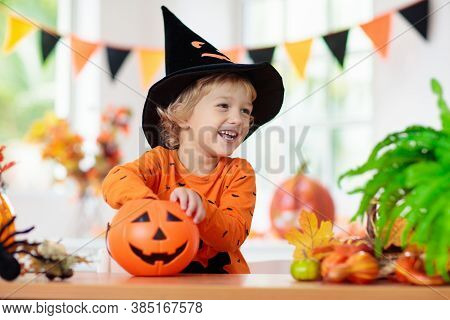 Child In Halloween Costume. Kids Trick Or Treat.