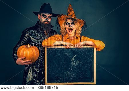 Best Ideas For Halloween. Halloween Couple. Cute Man And Woman Wearing Halloween Clothes. Party And
