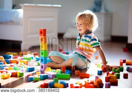 Child Playing With Colorful Toy Blocks. Kids Play.