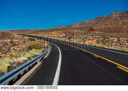 Landscape With Orange Rocks, Sky With Clouds And Asphalt Road In Summer. American Roadtrip