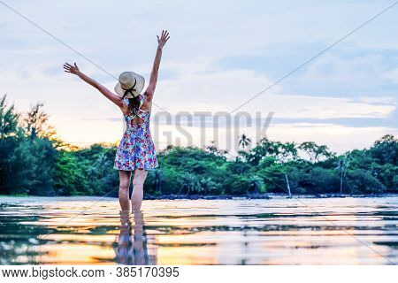 Carefree Woman Feeling Free While Standing In The Water