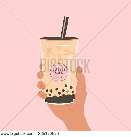 Hand Holding A Cup Of Famous Taiwanese Bubble Tea On Pink Background. Take Away Glass With Sticker O