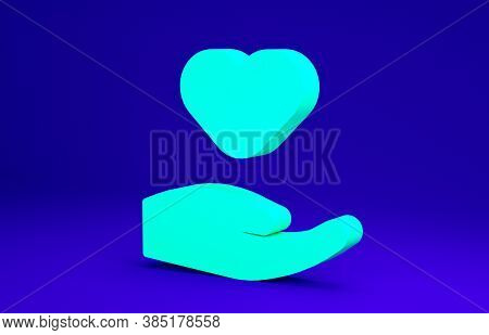 Green Heart In Hand Icon Isolated On Blue Background. Hand Giving Love Symbol. Valentines Day Symbol