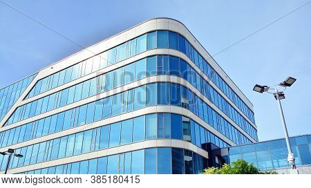 Office Building, Blue Glass Wall Reflection Detail. Modern Office Building And Clear Sky Background.