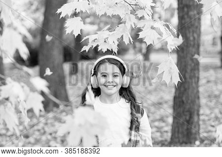 Cute Child Smile With Stereo Headphones. Melody Of Autumn. Schoolgirl Listening Modern Headphones. H