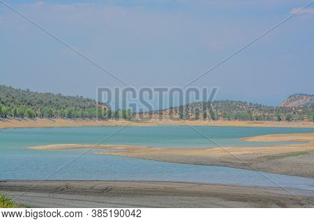 The Low Water Level At Crawford Reservoir In Gunnison National Park, Colorado