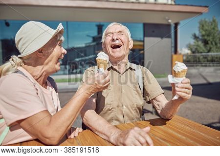 Merry Caucasian Pensioners Enjoying Each Other Company