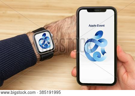 Man Is Watching Apple Event 2020 Using Iphone And Watch. Apple Logo On The Device Screen. Presentati
