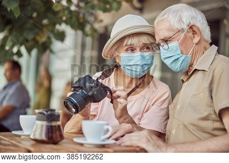 Female Photographer Gazing At A Gray-haired Man