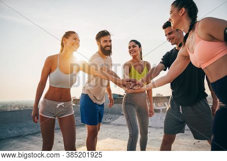Group Of Fit Healthy Friends, People Exercising Together Outdoor