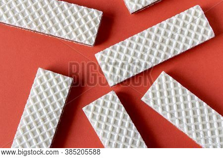 Several Waffles With Chocolate On A Red Background