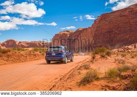 Utah/arizona, Usa: April 6, 2019: Road And Red Rocks At Monument Valley, Arizona, Usa