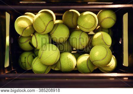 Basket with big tennis balls, top view, nobody