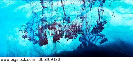 Closeup Of A Blue, Black And Red Ink In Water In Motion Isolated On White. Ink Swirling Underwater.