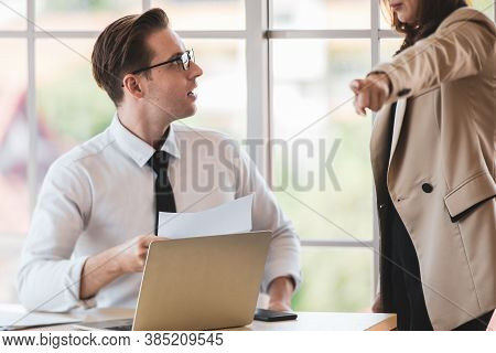 Businesswoman As Boss Point Finger And Order Businessman Employee To Get Out While Business Man Look