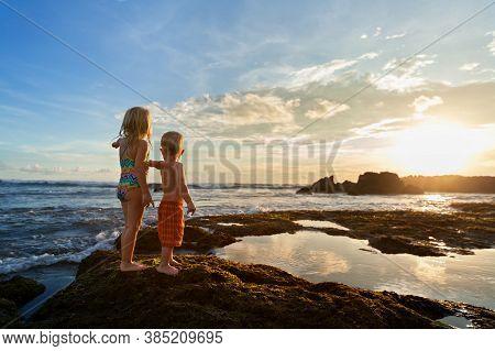 Happy Kids Walk With Fun On Sea Beach Resort. Little Siblings Or Best Friends - Funny Baby Boy, Youn