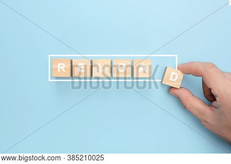 Man Hand Holding Wooden Cube With Restart Word On Blue Background. Hand Putting Wooden Cube On Virtu
