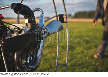 Individual Backpack Paralet With Gasoline Engine. Preparation For Wing Flight. Extreme Sports. Paral