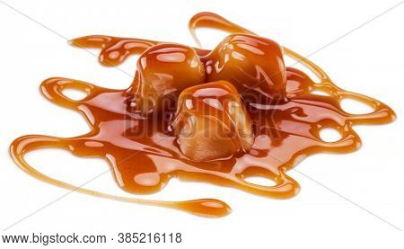 Caramel candies covered with melted sugar caramel isolated on white background.
