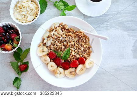 Healthy Breakfast Bowl, Fresh Granola, Fruits And Coffee.