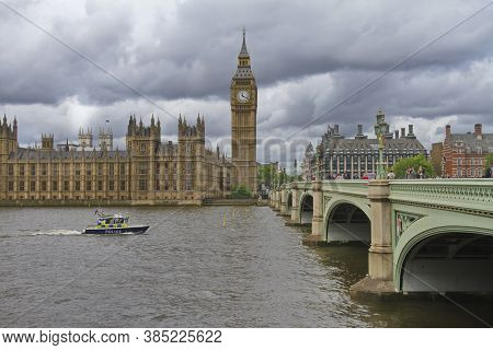 London, England; May 24, 2014. The English Police Patrol The River Thames With The Parliament And Bi