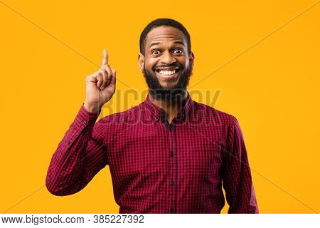 Great Idea Concept. Young Funny African American Man Pointing Finger Up. Excited Black Guy Got Solut