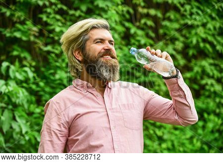 Just Smile. Bearded Man Hold Plastic Bottle Of Water. Feeling Thirsty. Drink Some Water While Walkin