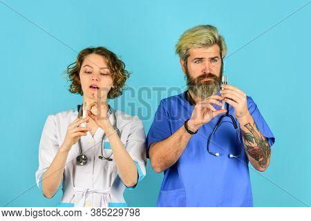 Coronavirus Prevention. Medicine Vaccination Equipment With Needle. Nurse And Doctor Team. Free Vacc