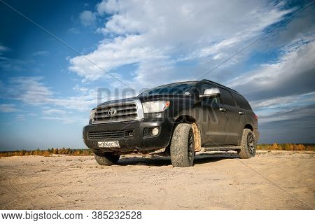 Novyy Urengoy, Russia - September 6, 2020: Dirty Luxury Car Toyota Sequoia (xk60) At The Countryside
