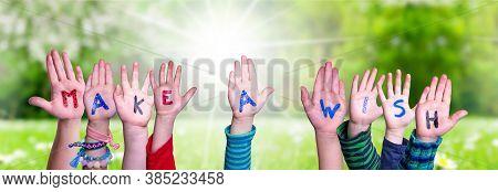 Children Hands Building Word Make A Wish, Grass Meadow
