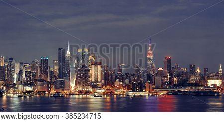 Manhattan midtown skyscrapers and New York City skyline at night panorama