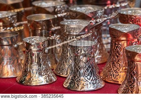 Sarajevo, Bosnia and Herzegovina - August 27, 2019: Traditional bosnian copper cezve coffee pots as popular souvenirs and handicrafts for sale in Sarajevo old town