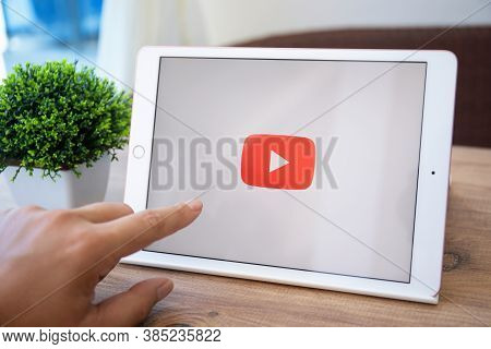 Alanya, Turkey - September 10, 2020: Man Hand Touch Ipad 7 Gold With Application Video Service Youtu