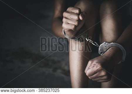 Woman Hands In Handcuffs, Human Trafficking Concept, Stop Violence Against Women And Human Trafficki