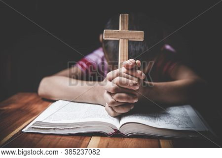 Religious Christian Child  Praying Over Bible Indoors, Religious Concepts. Religious Beliefs Christi