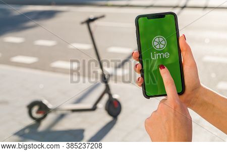 Berlin, Germany August 2019: Woman Hand Holding Iphone Xs With Logo Of Lime App Displayed On A Smart