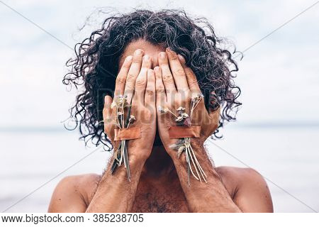 Young Handsome Man Cover His Face With Hands On The Beach