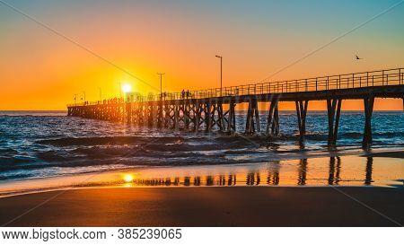 People Walking On Port Noarlunga Jetty At Sunset, South Australia