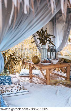 Still Life Summer Garden Pavilion With Blue Designer Pillows