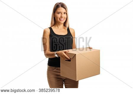 Young woman holding a cardboard moving box isolated on white background
