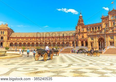 Seville, Andalusia, Spain - April 18, 2016: Horse Carriage Ride In Plaza De Espana With Central Buil