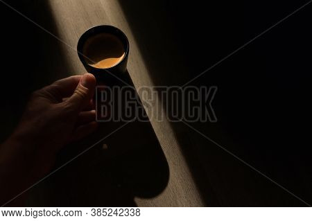 Conceptual  Espresso Coffee Cup And Sunray On Wooden Table