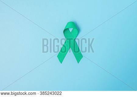 September Ovarian Cancer Awareness Month, Teal Ribbon Color On Blue Background For Supporting People