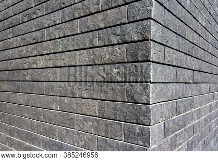 The Corner Of The House Is Made Of Gray Tiles That Imitate Brickwork. Modern Finishing Material. The