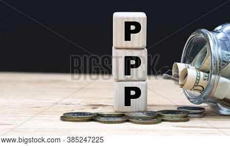 Ppp (paycheck Protection Program) - On Cubes On The Background Of A Capacity With Money. Business An