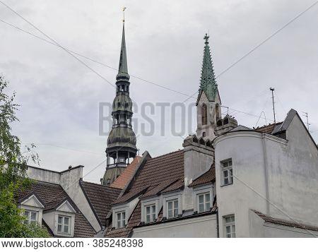 Riga, Latvia. Church Roofs In Riga, Cloudy Day